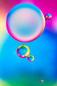 drops of oil and air bubbles on the water