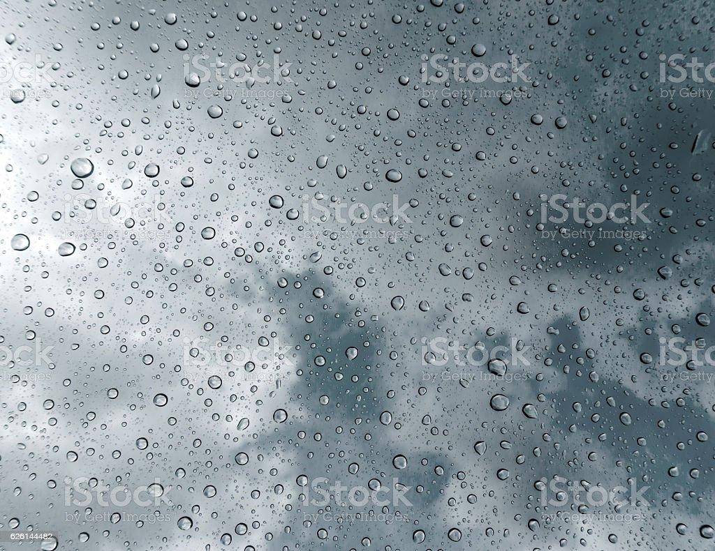 Drops of rain on glass stock photo