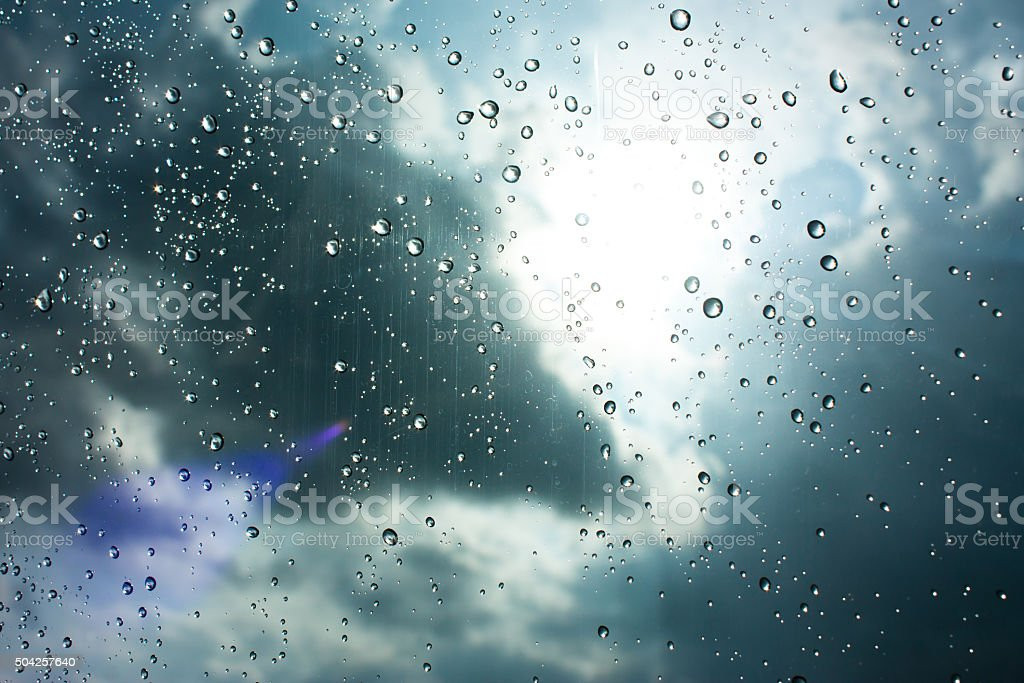 Drops of rain on glass , rain drops on clear window stock photo