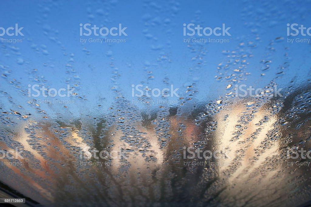 Drops of rain on window stock photo