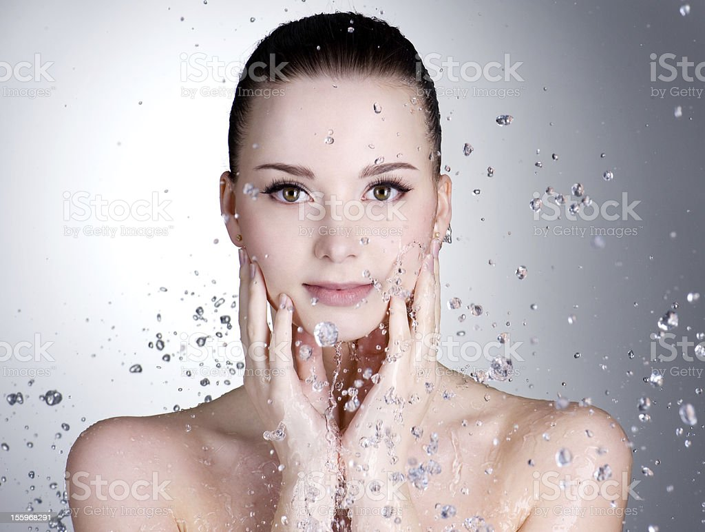 Drops of water around the beautiful woman face stock photo
