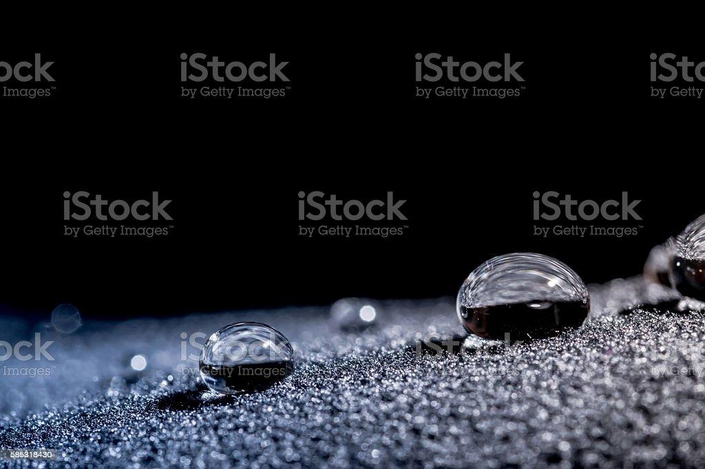 Drops of water close-up macro on velvet stock photo