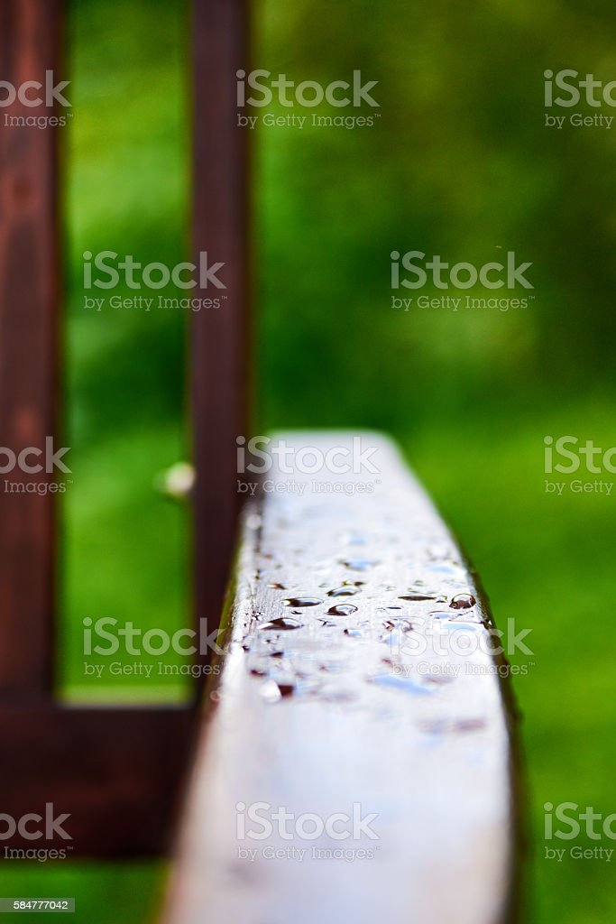 Drops of water on the wooden handle stock photo