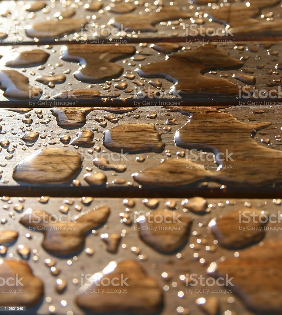 Drops on a wooden surface royalty-free stock photo