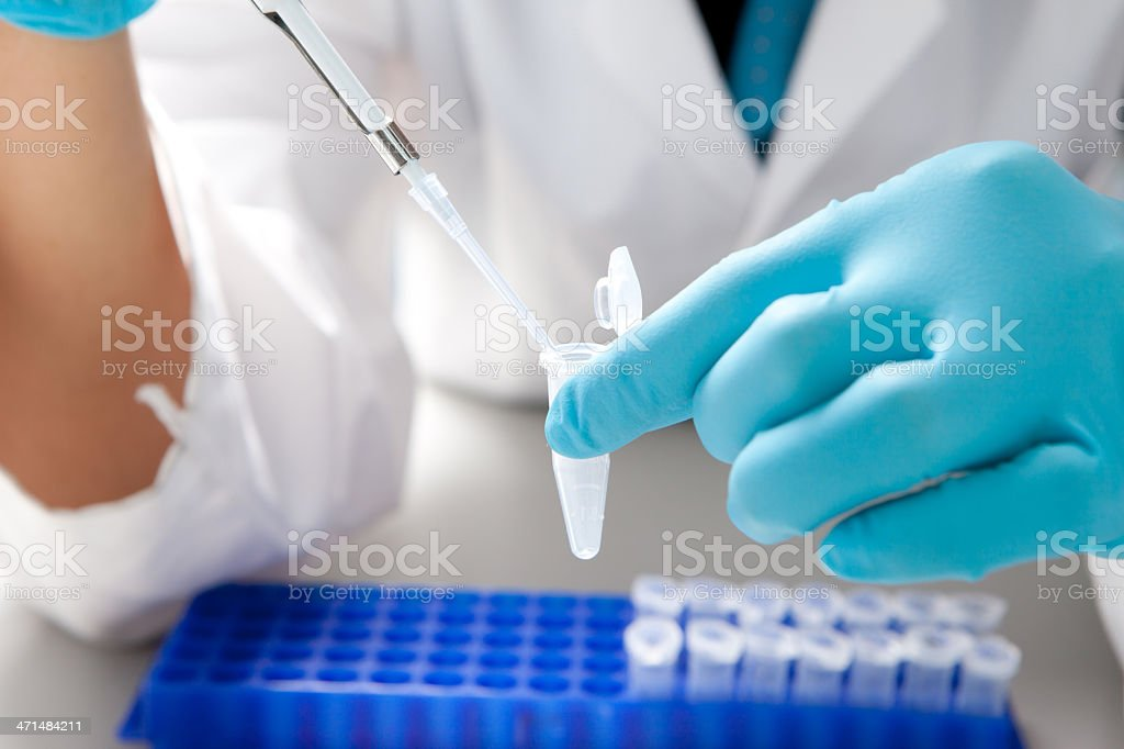 Drops the biological solution in eppendorf stock photo
