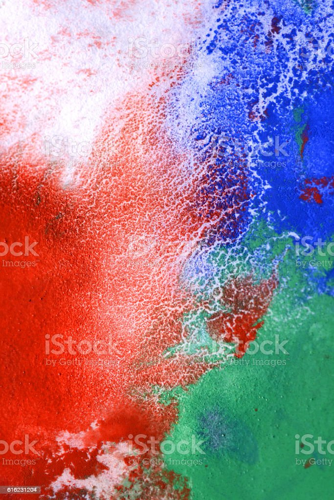 drops with streaks of different colors paint are mixed and stock photo