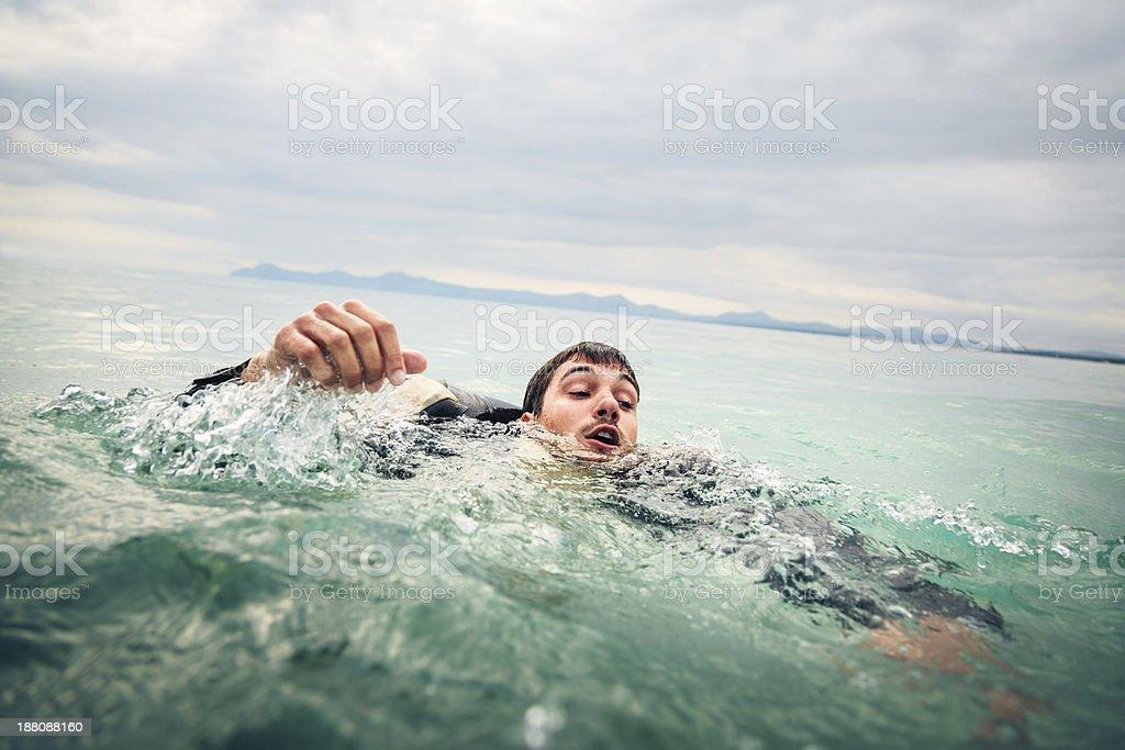 drowning businessman stock photo