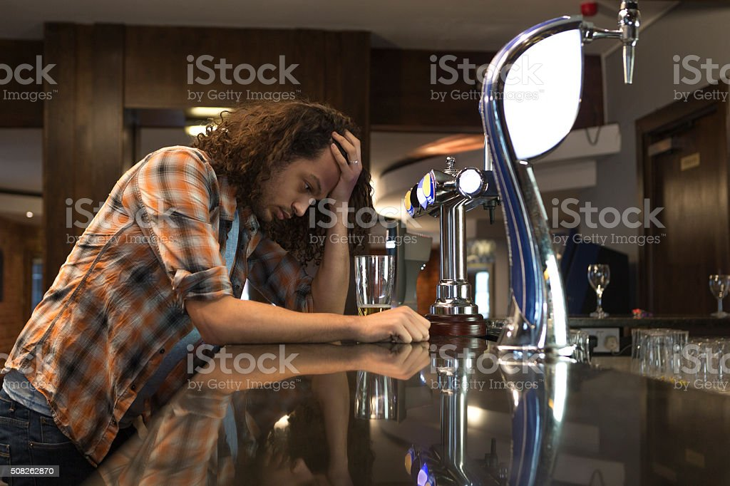 Drowning his sorrows stock photo