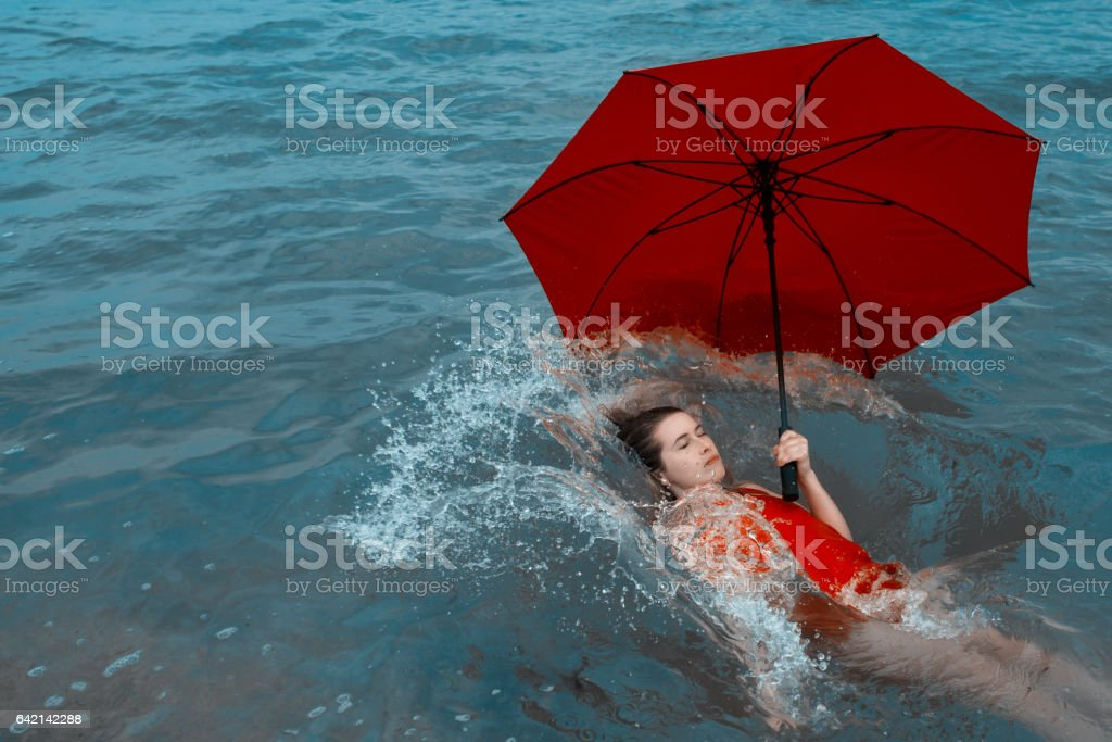 drowning, let your feelings fall apart stock photo