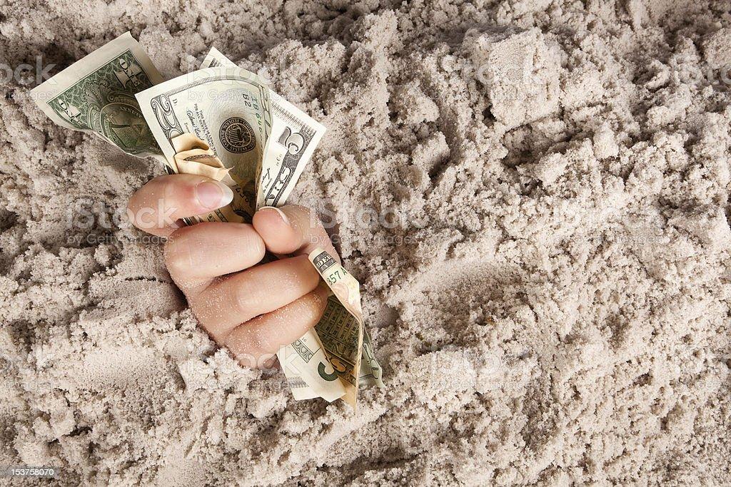 Drowning money royalty-free stock photo