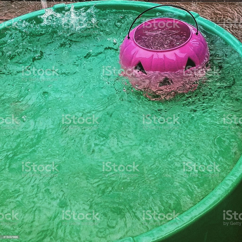 Drowning Pumpkin Candy Bucket stock photo