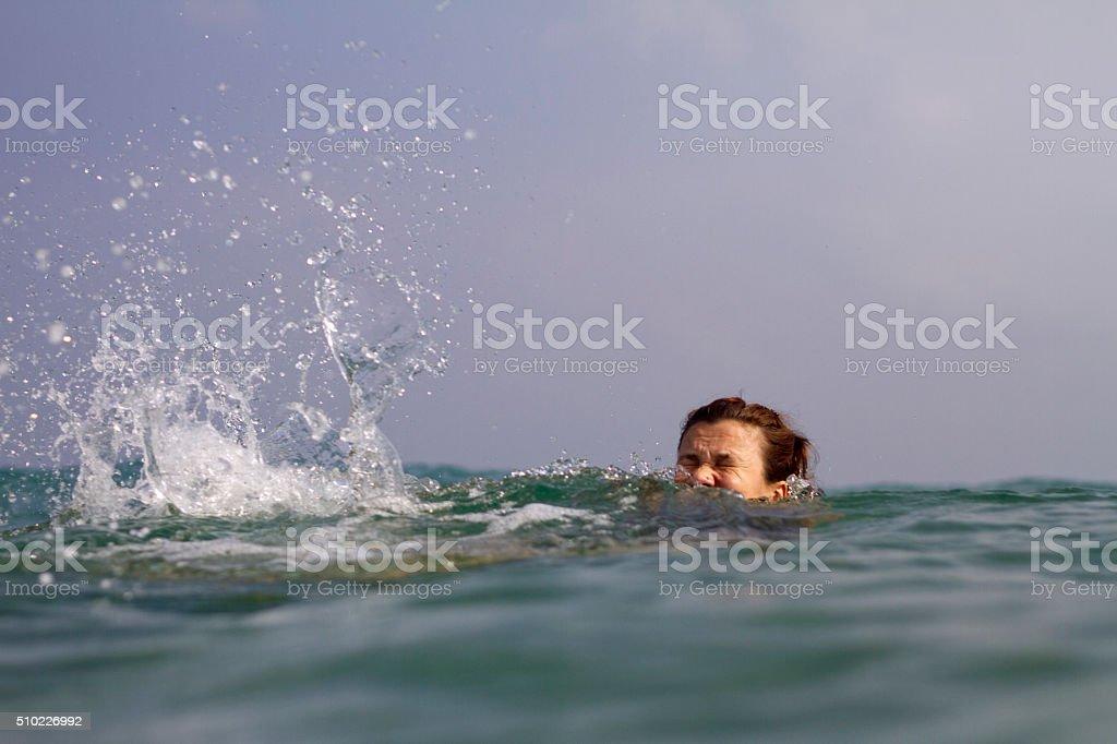 drowning woman stock photo