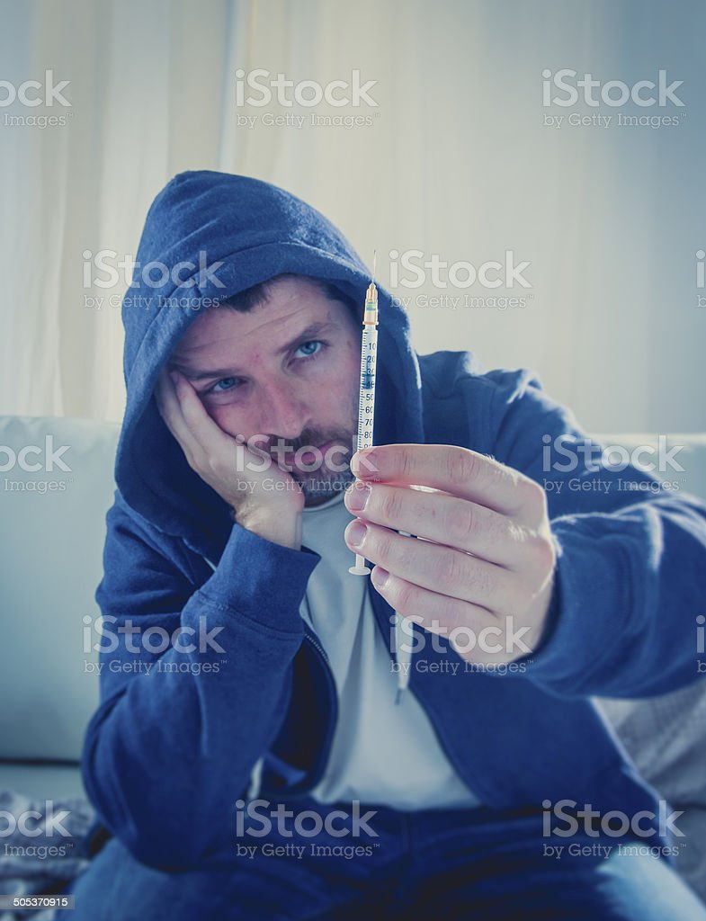 drug addict getting heroin syringe ready to inject the shot stock photo