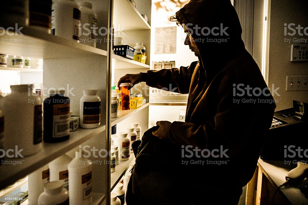 Drug addict stealing prescriptions. stock photo