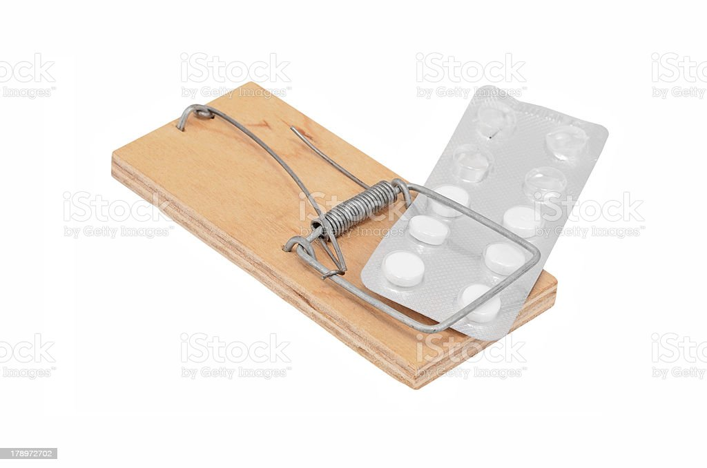 Drug addiction concept - mouse trap and tablet royalty-free stock photo