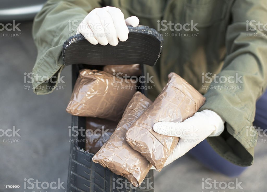 Drug bundles found in spare tire stock photo