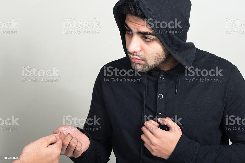 Drug dealer selling to customer stock photo