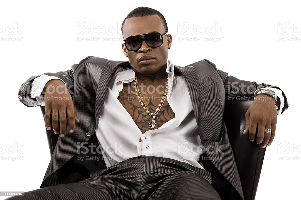 Drug dealer sit on couch stock photo