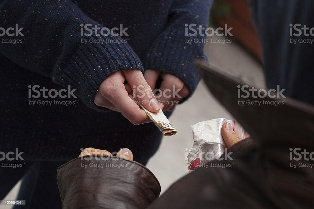 Drug dealer taking  money stock photo