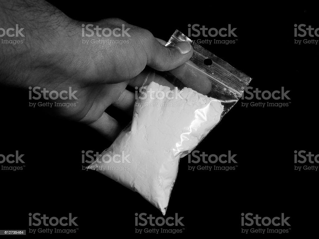 Drug dealer with cocaine drug powder bag stock photo