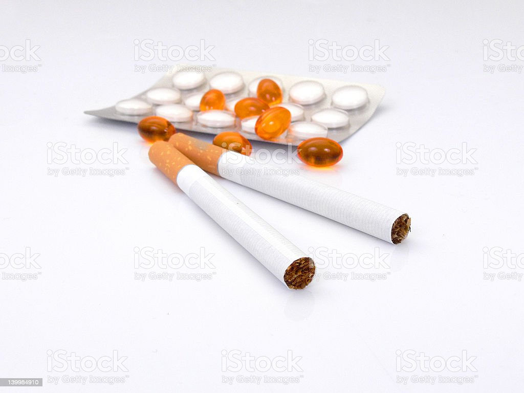 Drug pills and cigarettes stock photo