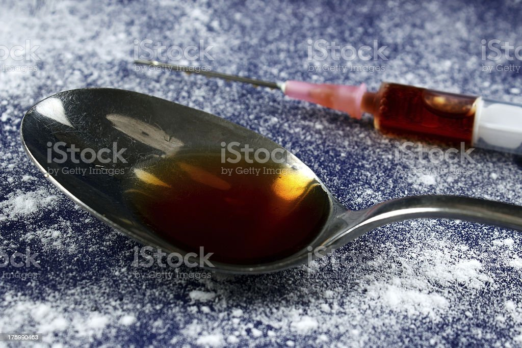 Drug syringe and spoon royalty-free stock photo