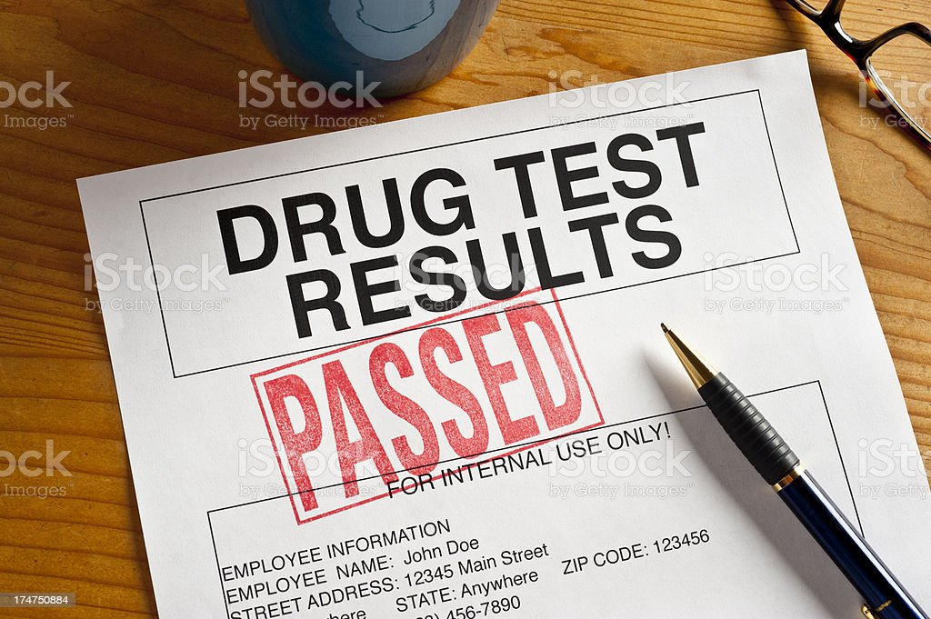 Drug test results stands with 'passed stock photo