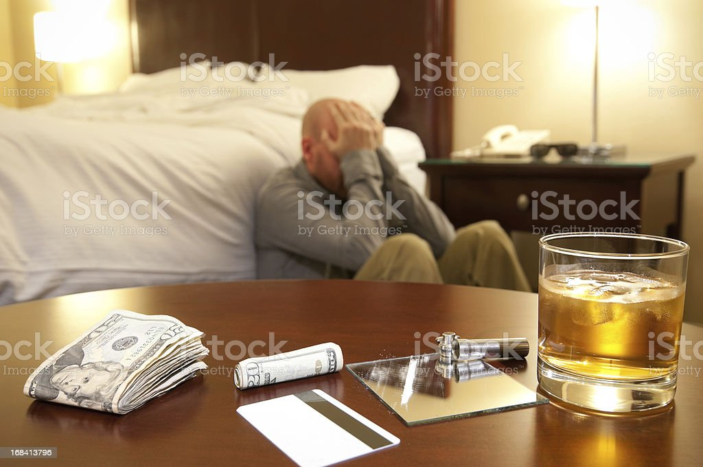 Drug use and distraught man stock photo