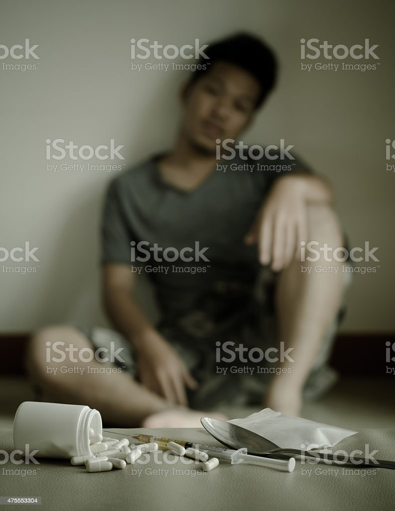 drugs and drug addict, sitting in the background stock photo