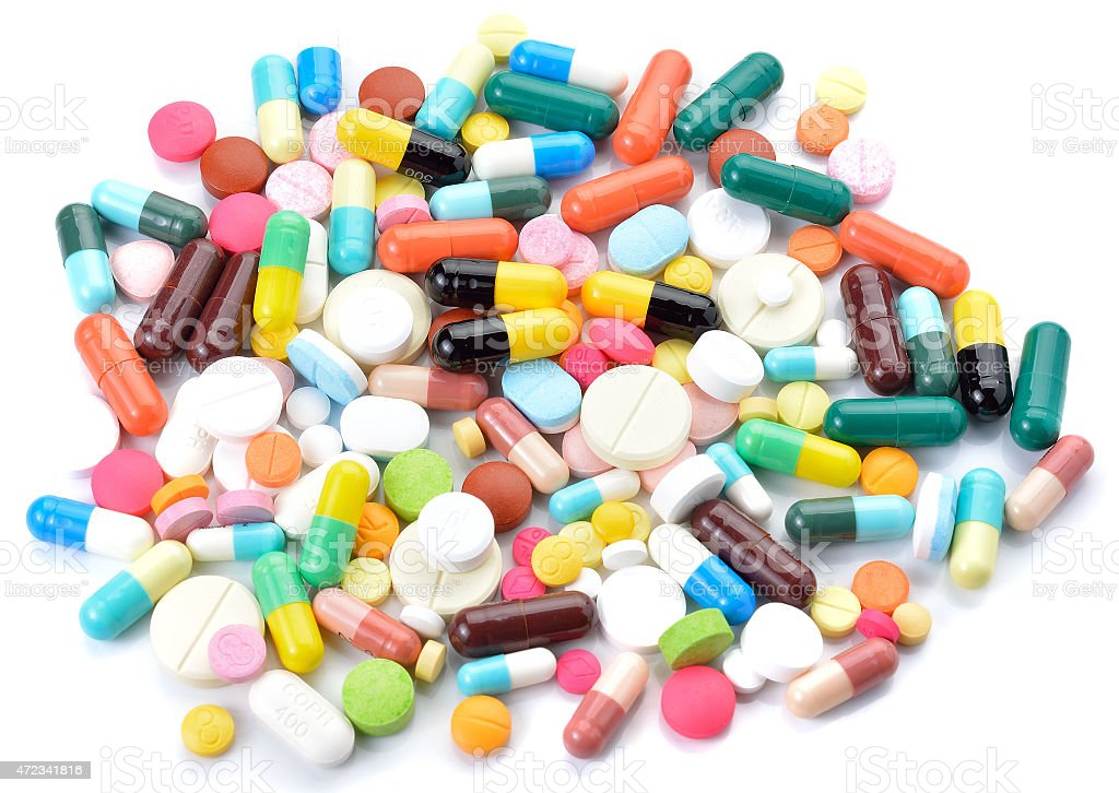 drugs capsules and pills on white background stock photo