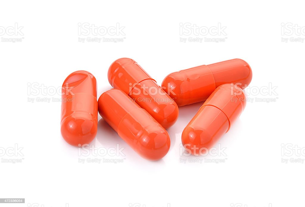 drugs capsules on white background stock photo