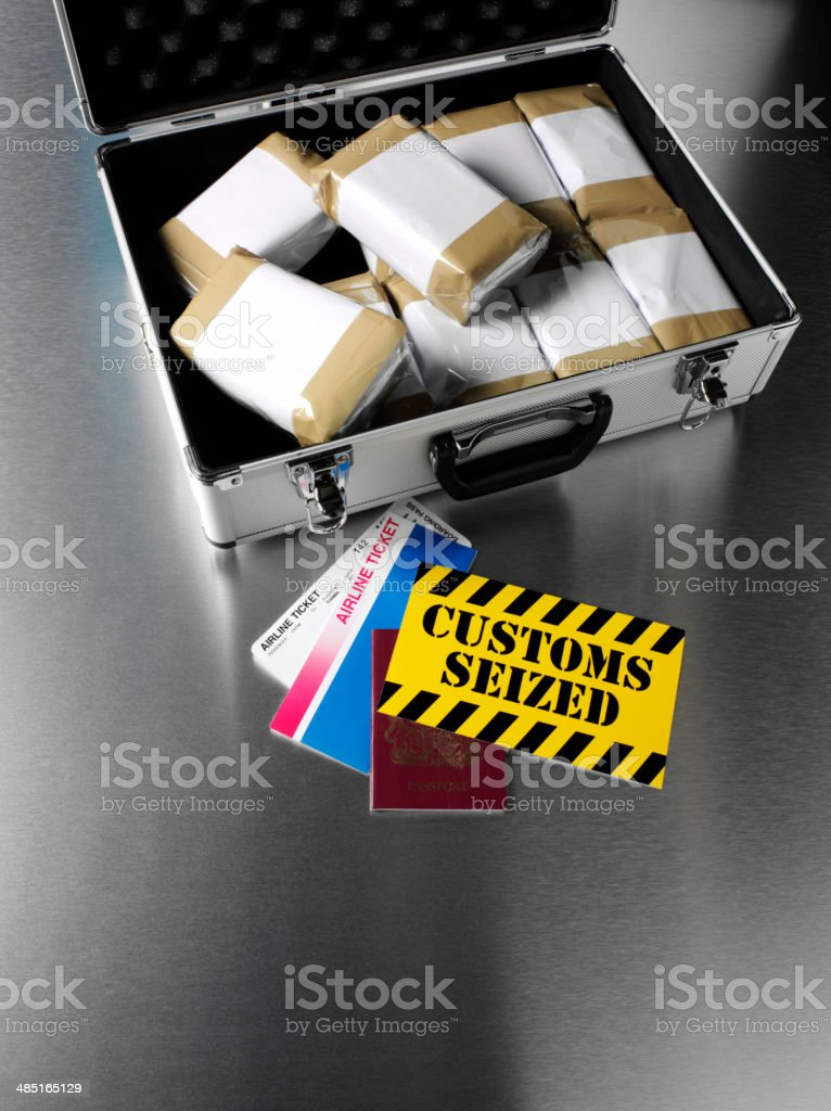Drugs in an Attache Case with Passport and Flight Ticket royalty-free stock photo