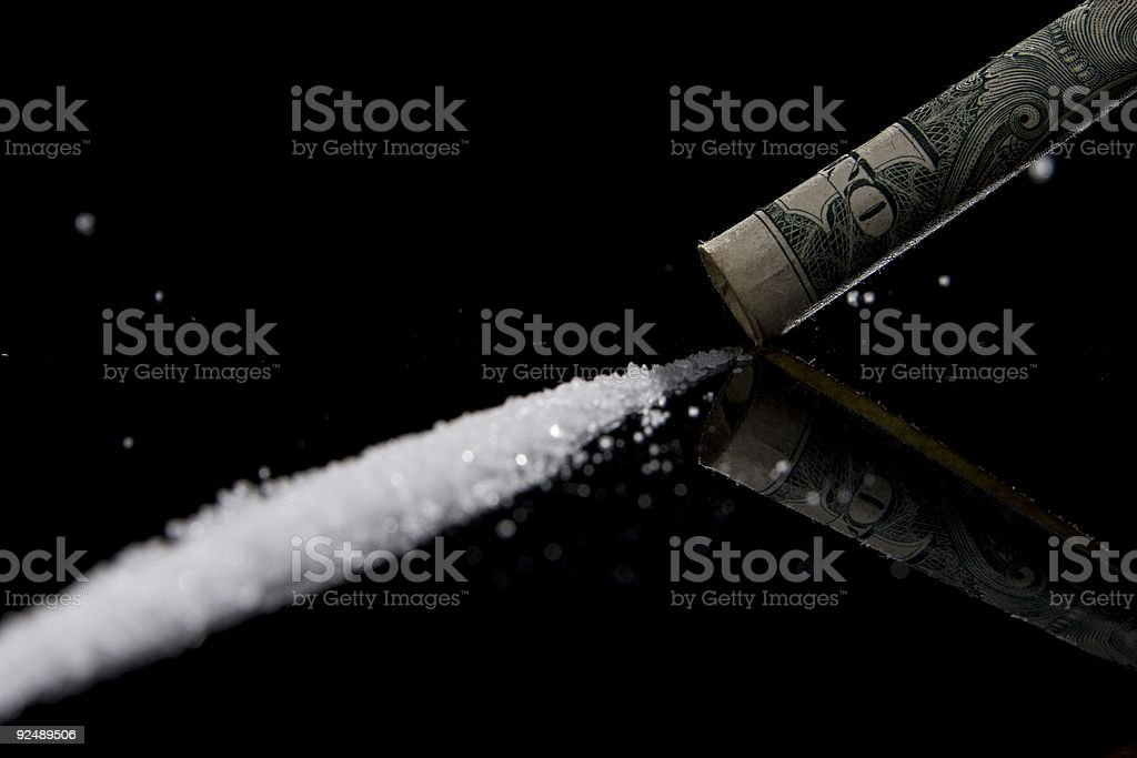 Drugs in powder form with a one dollar bill royalty-free stock photo