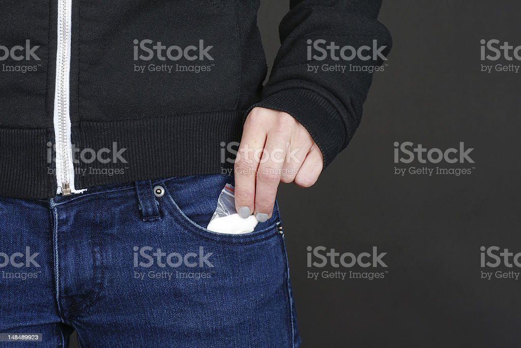 Drugs out of jeans pocket stock photo