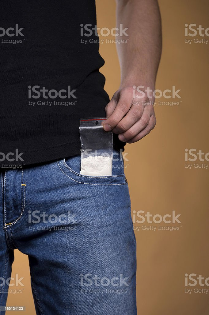 Drugs out of jeans pocket. royalty-free stock photo