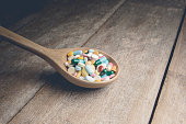 Drugs pill on wooden spoon for your treatment your health