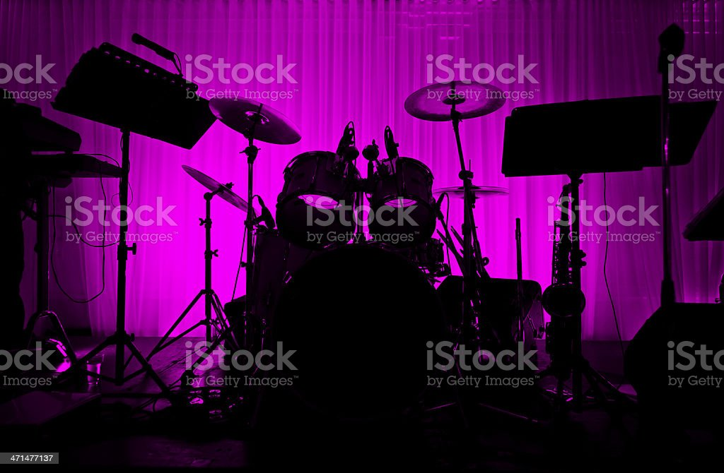 Drum in silhouette with no musician. stock photo