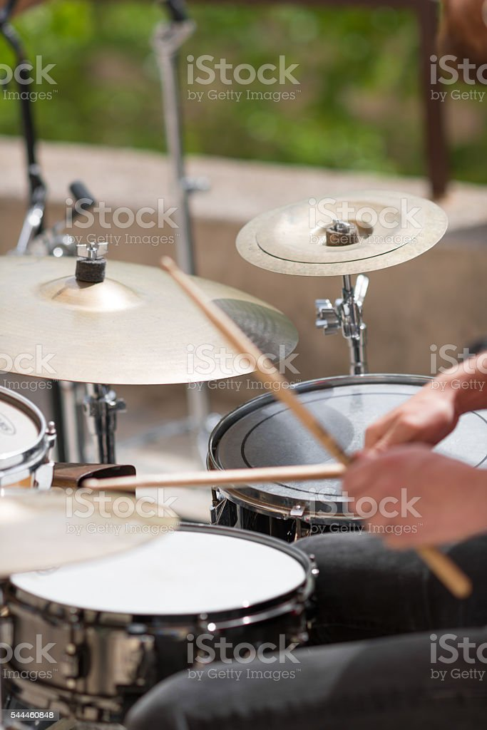 drum kit playing on street by street musician stock photo