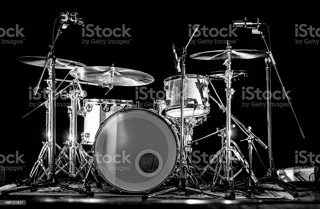 Drum Kit Set on Stage with Microphones stock photo