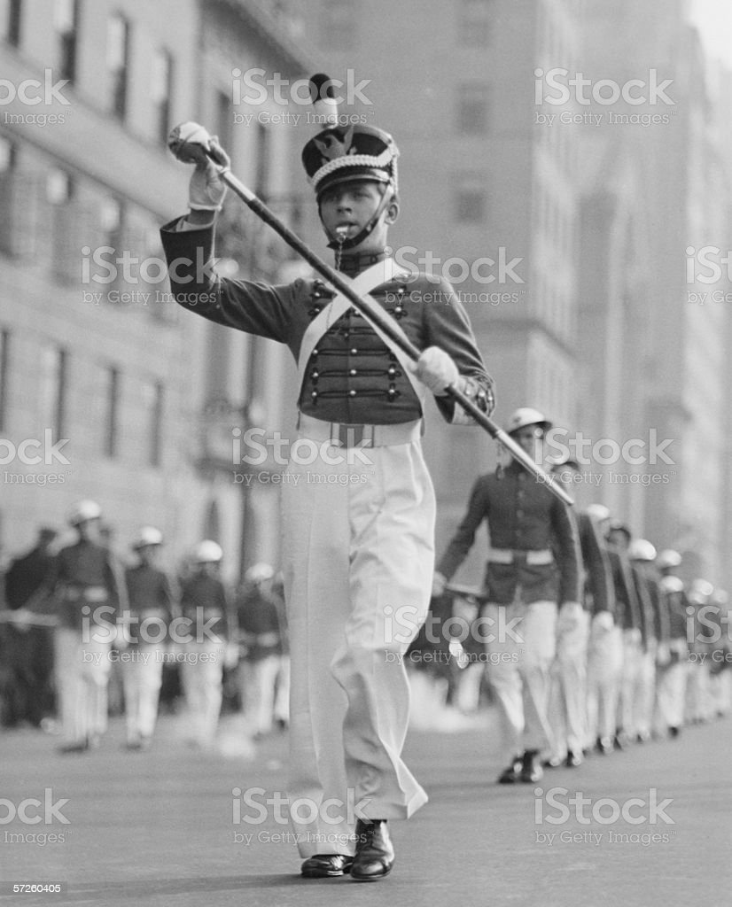 Drum major leading parade in old-fashioned uniforms, (B&W) stock photo