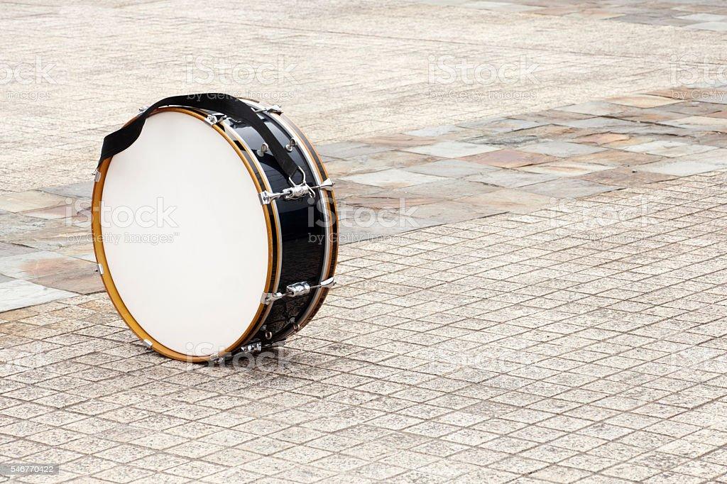 Drum on cobblestone. stock photo