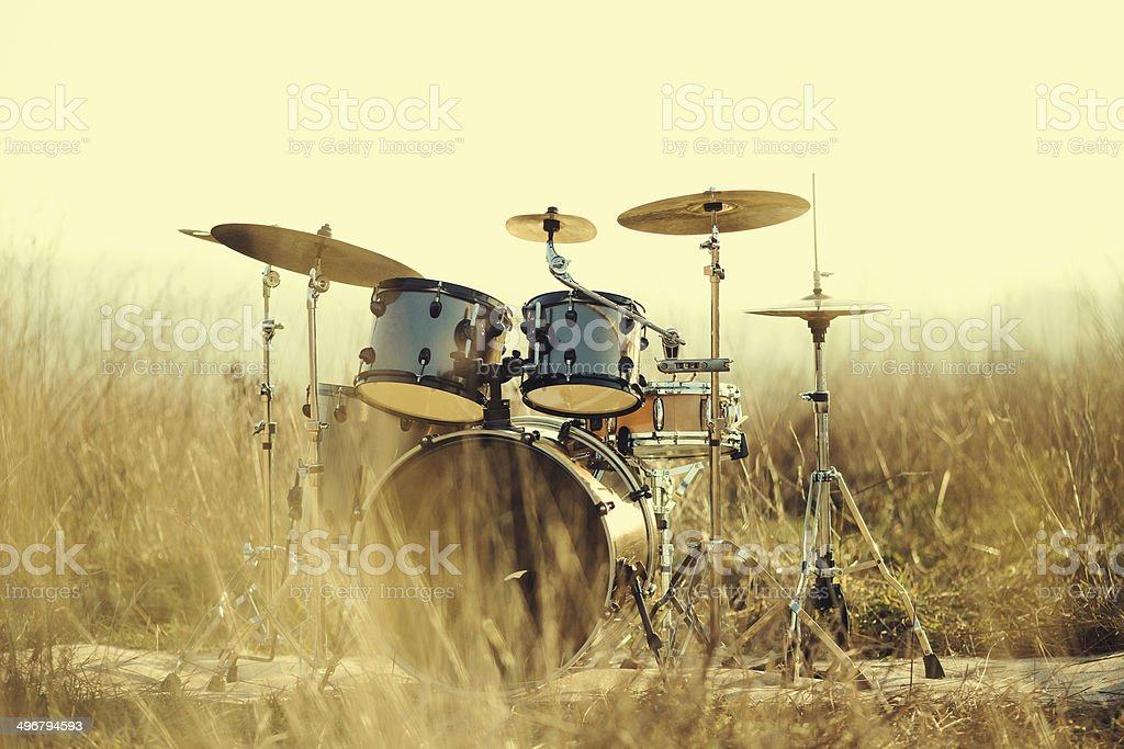 Drum set in the field stock photo