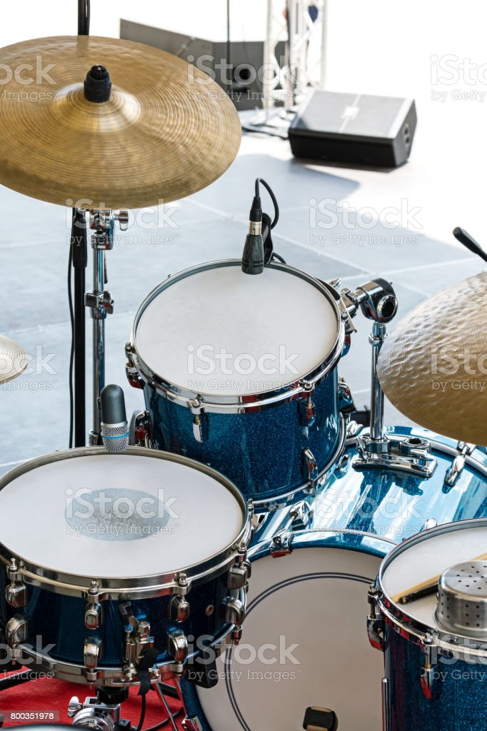 drum set on outdoor stage ready for play stock photo