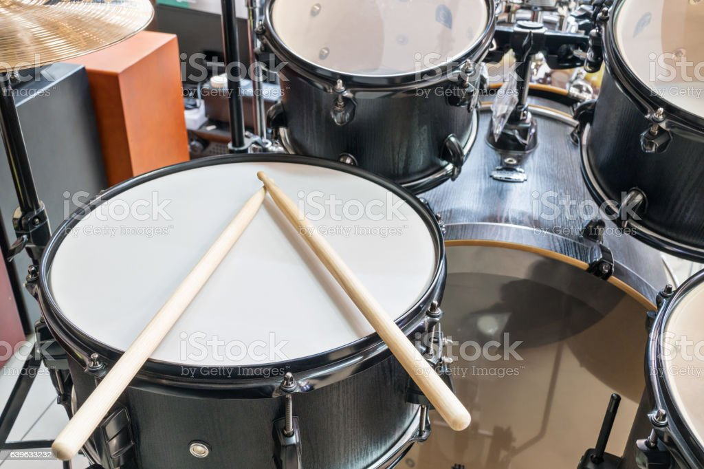 Drum set with drumsticks stock photo