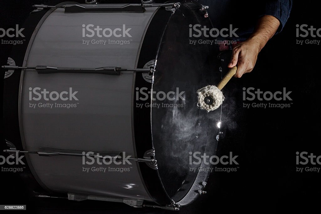 Drum sticks hit on the bass drum stock photo
