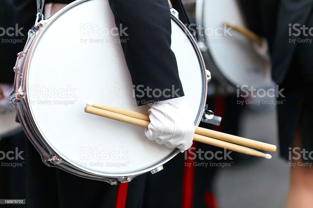 Drum with a hand and drumsticks on parade stock photo