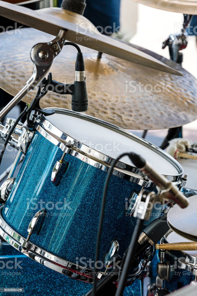 drum with copper plates of a drum kit standing on street scene stock photo