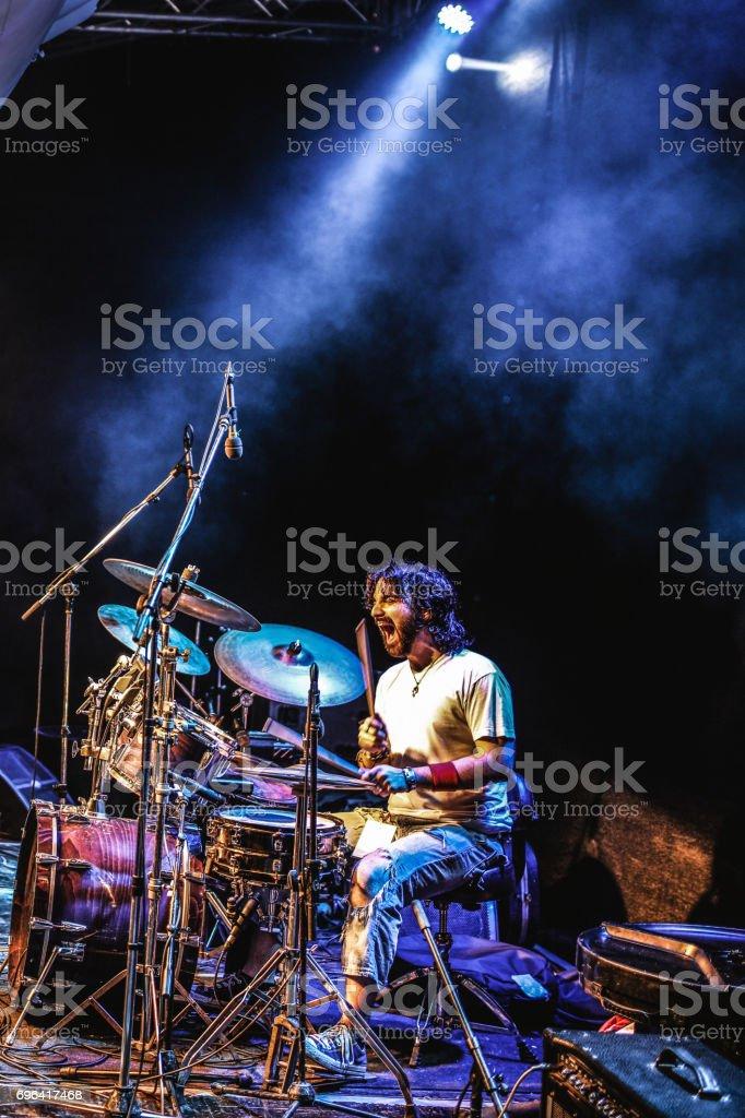 Drummer at rock concert stock photo
