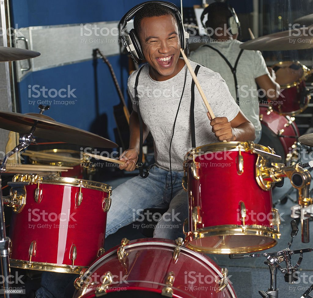 Drummer drifting away at the rhythm stock photo