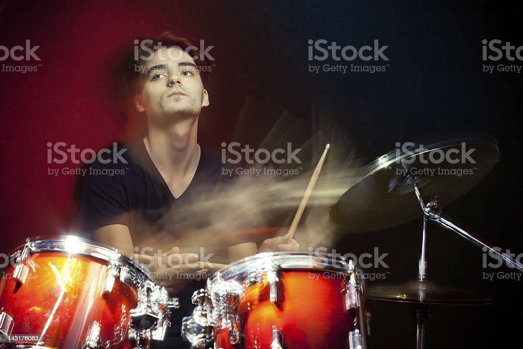 Drummer in motion playing drums stock photo